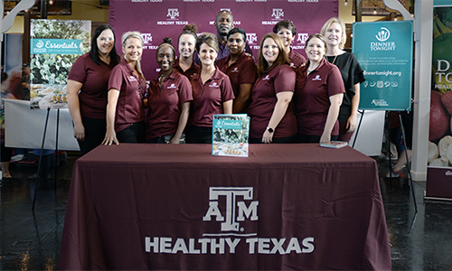 extension agents posing with cookbook at texas state fair.jpg