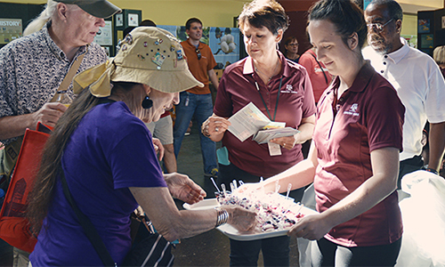 Extension agents passing out food samples